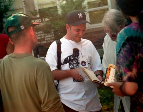 Gregory Corso Signs Autographs For Beat Fans Outside Boulder High School July 1994 Photo by Seth Brigham